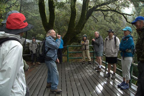 Ken Himes and CNPS hike audience at Castle Rock viewing platform.  Includes Alf Fengler with the hiking pole