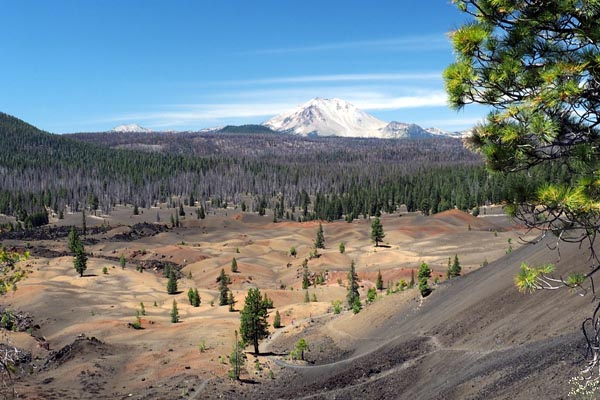 Snow covered Lassen Peak viewed from Cinder Cone, with foreground of the Painted Dunes.  Photo: Dee Wong